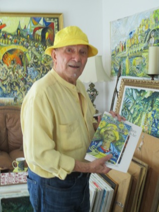 Fine Artist Ivo David with his book of poems Memories of an Artist.