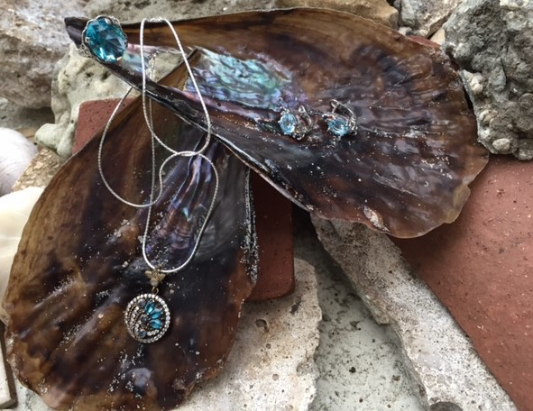 Aquamarine jewelry on shells close up