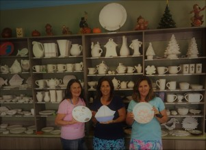 GetShotByElla.com artists display their newly painted plates before the firing process at the Painted Frog, Vero Beach, FL.