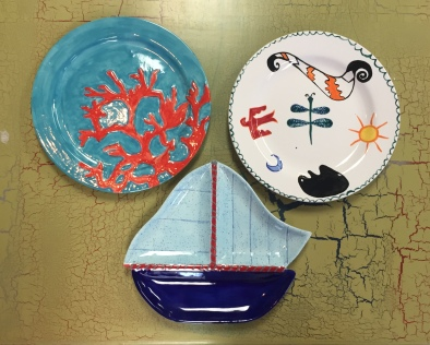 GetShotByElla.com artists display their newly painted plates after the firing process at the Painted Frog, Vero Beach, FL.